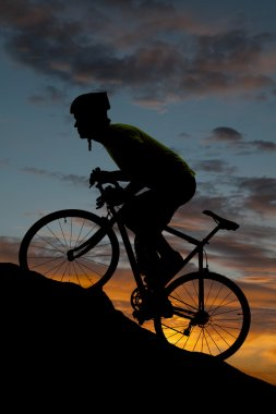 Silhouette road bike uphill