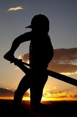 Silhouette baseball swing beginning sunset