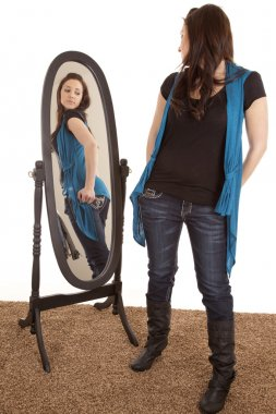 Woman looking at self in mirror