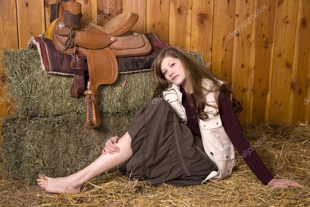 https://st.depositphotos.com/1712366/2958/i/950/depositphotos_29581193-stock-photo-woman-on-ground-by-saddle.jpg