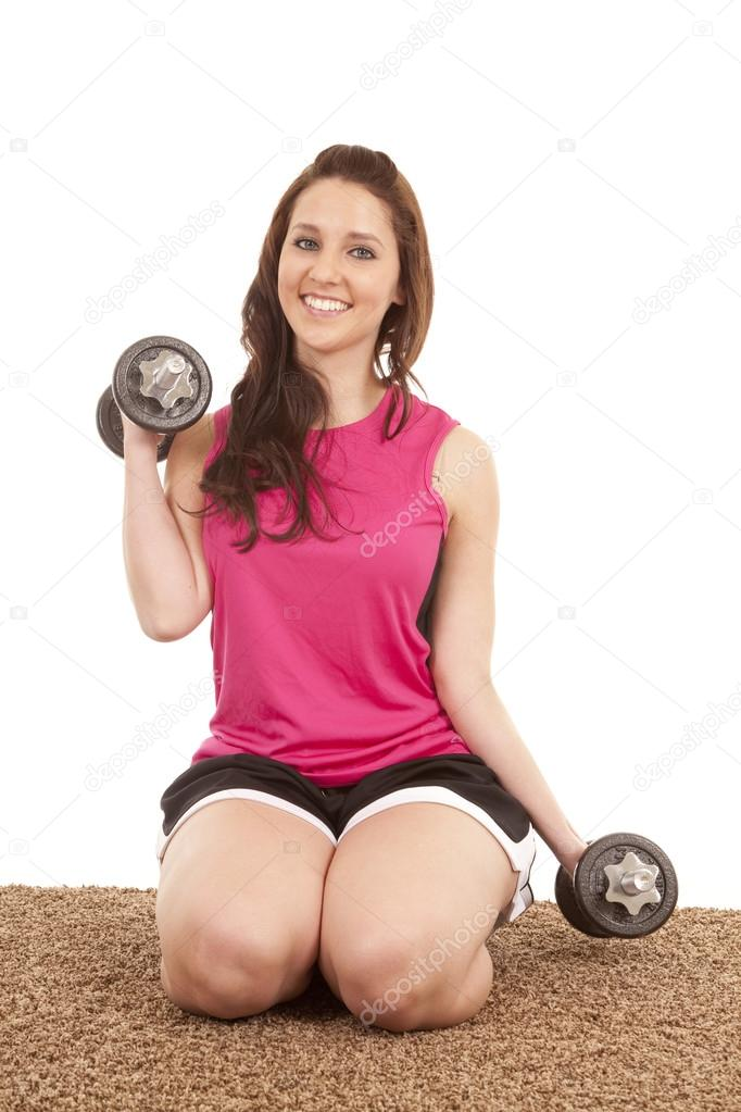 woman kneeling weights stock photo alanpoulson 29583515