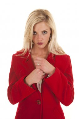 Woman red coat hold knife by chest looking