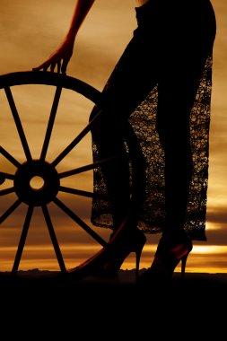 Silhouette woman lace skirt wagon wheel legs