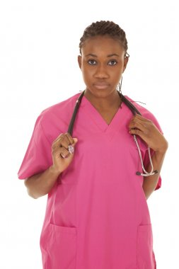 Nurse in pink with stethoscope serious