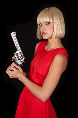 Woman red dress on black gun side serious