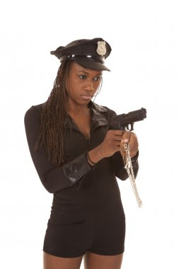 Cop woman with gun and cuffs angle