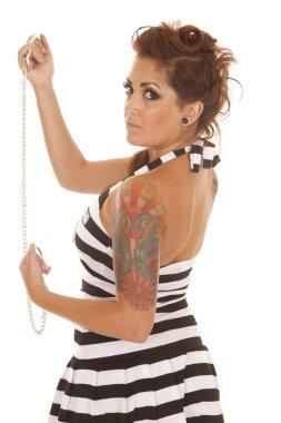 Woman tattoos back handcuffs serious