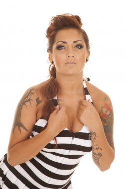 Woman tattoos prison hands by chest