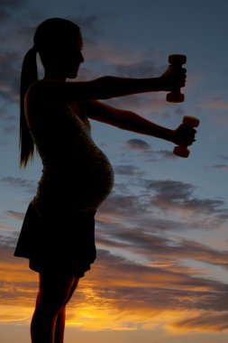 Silhouette pregnant with weights