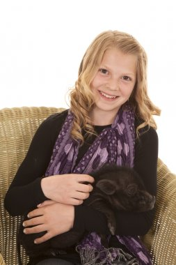 young girl pose sit with pig looking