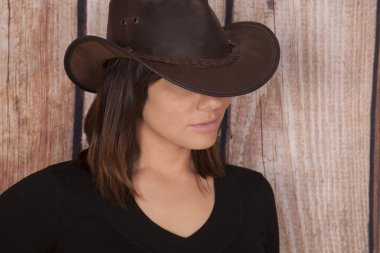 woman cowgirl wooden wall close serious
