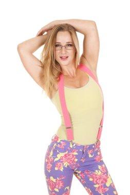 Woman pink suspenders glasses hands head