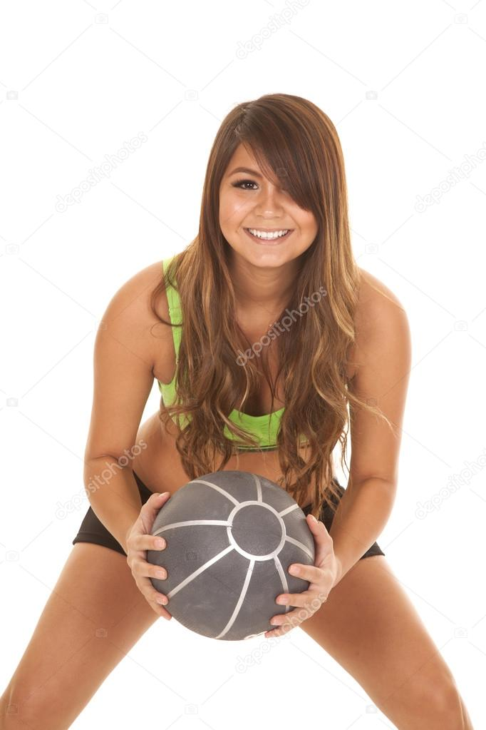573f37810bebe A Native American holding up her weighted medicine ball with a happy  expression on her face. — Photo by alanpoulson