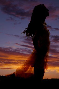 Silhouette woman dress kneeling