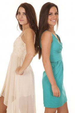 Two women dresses back to back