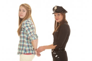 Woman cop handcuff woman behind back