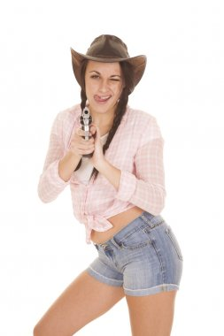 woman pink plaid shirt gun tongue out