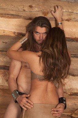 A man seducing an Indina woman by a wood wall. stock vector