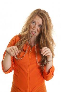 Woman inmate cuffs sad chain