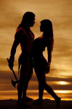 silhouette couple indian facing hatchet