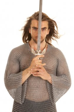 man chain mail sword front of face looking