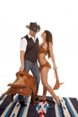 Cowboy and Indian woman saddle and club