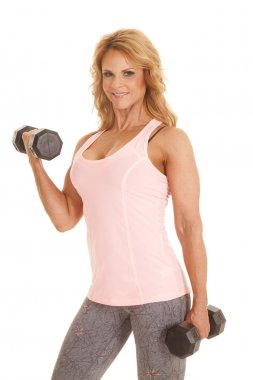 Mature woman fitness curl looking