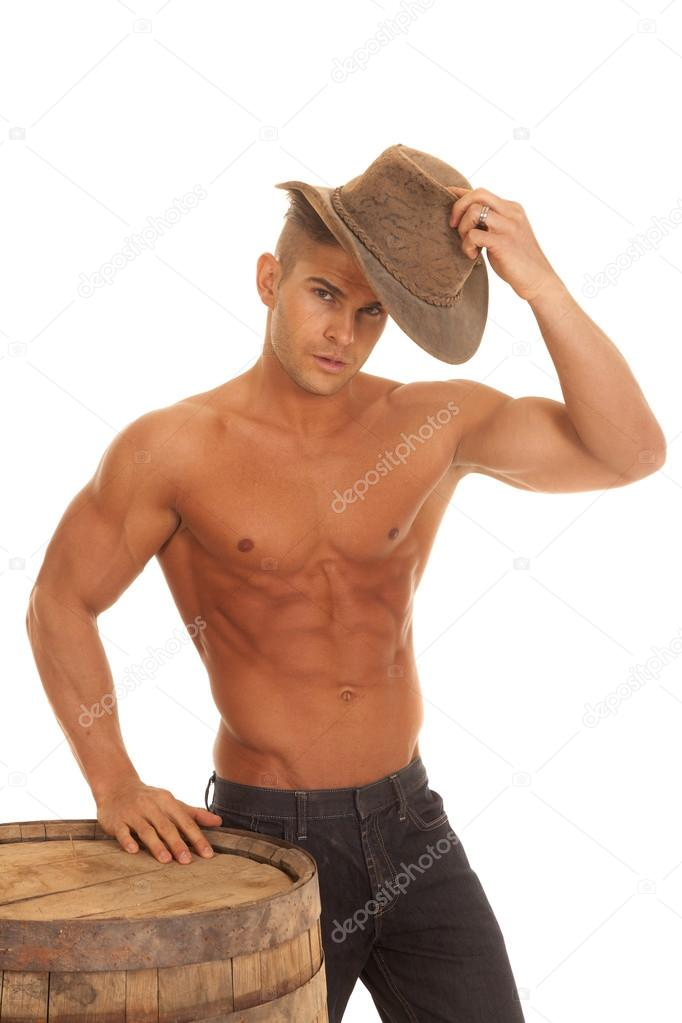 Man Strong No Shirt Barrel Putting On Hat Stock Photo