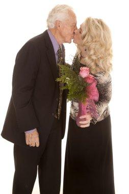 elderly couple roses kiss