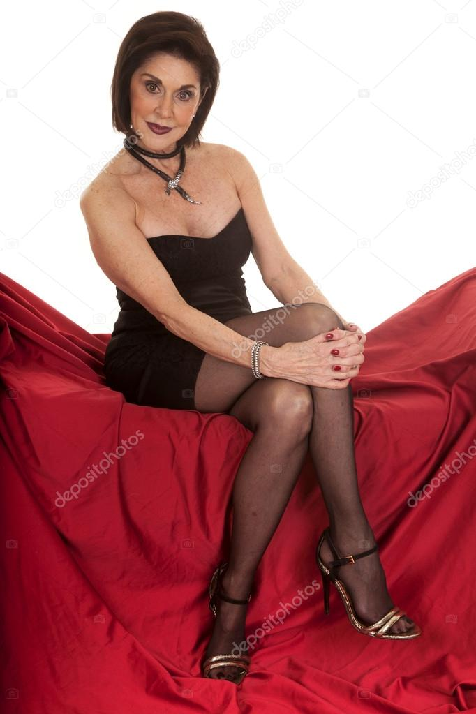 Mature women legs Older Woman Black Dress Sit On Red Legs Crossed Stock Photo By C Alanpoulson 41958043