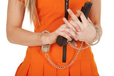 prisoner orange gun body clasp hands