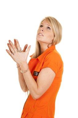 prisoner orange handcuffs look up pray