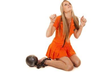 prisoner orange kneel ball look up