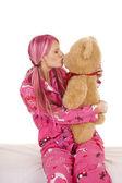 woman pink pajamas kiss stuffed animal bear