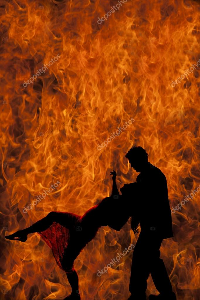 silhouette of man holding woman in fire