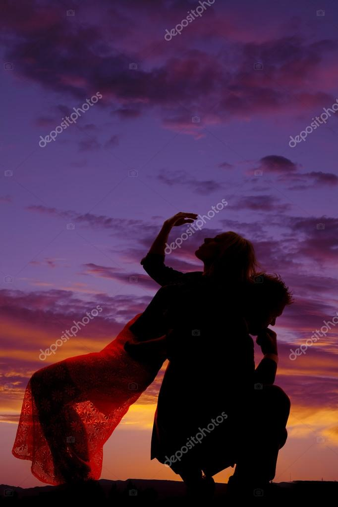 silhouette woman lean back on man hand over face