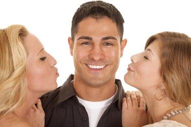 two women ready to kiss man close big smile
