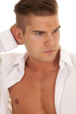 man white dress shirt unbottoned close hand behind head