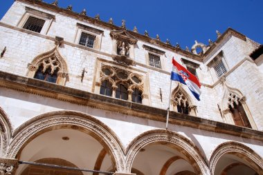 Sponza Palace(Dubrovnic) with flag of Croatia.