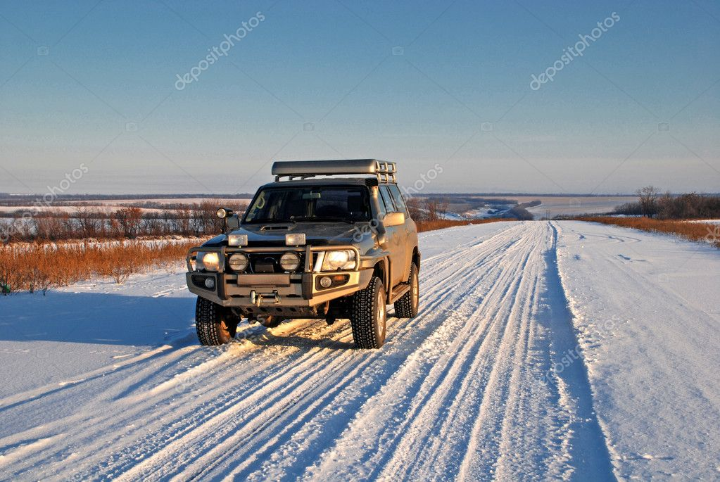 Winter road with car 4x4
