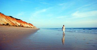woman on coastline of ocean
