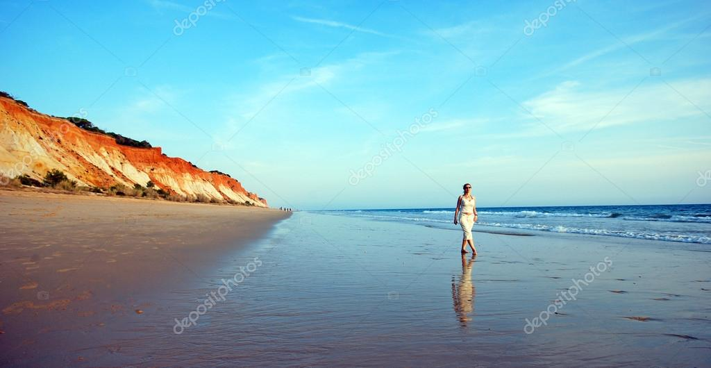 woman on coastline of ocean