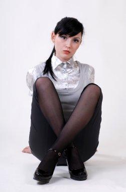 beautiful woman sits cross-legged