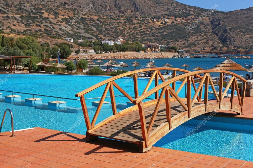 Swimming pool, foot bridge and beach in resort(Greece ...