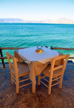 greek outdoor restaurant with Mediterranean sea view(Crete, Gree