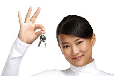 Cute asian chinese girl showing flat keys
