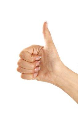Beautiful female hand making thumb up gesture