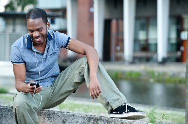 Young guy smiling to music