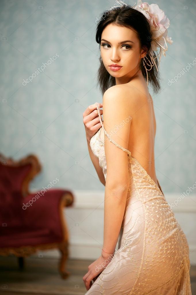 Portrait of a Beautiful Bride Holding Her Shoulder Strap