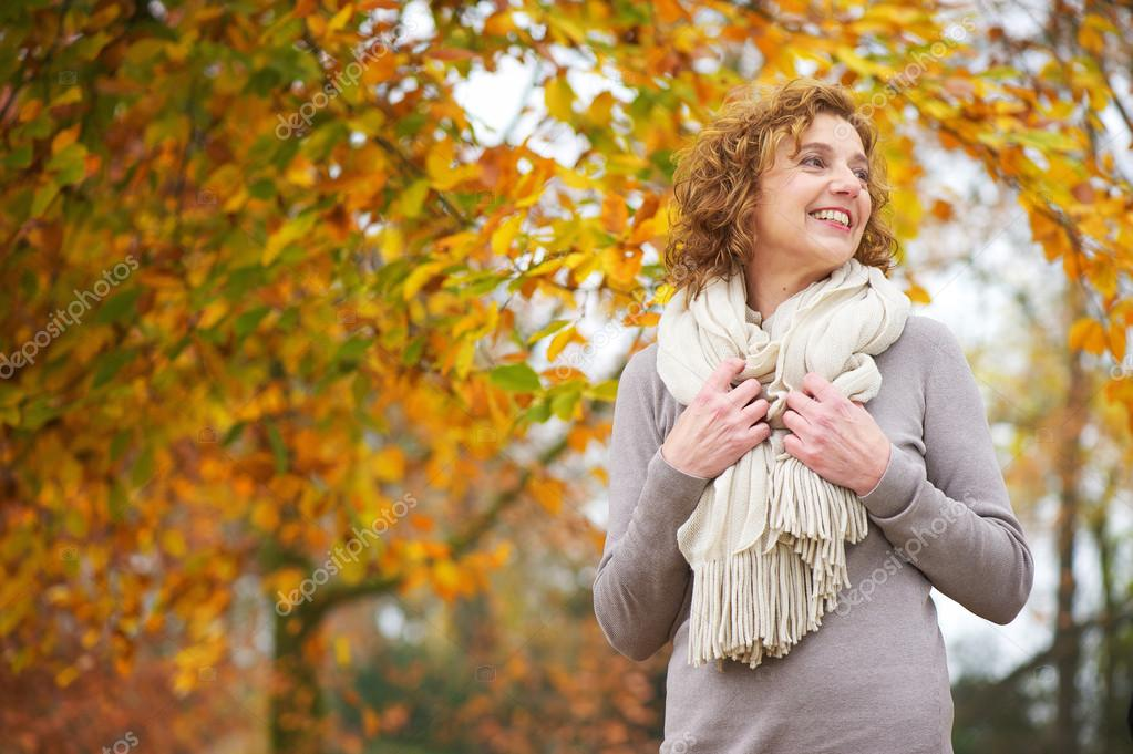 Older Woman Smiling in Autumn